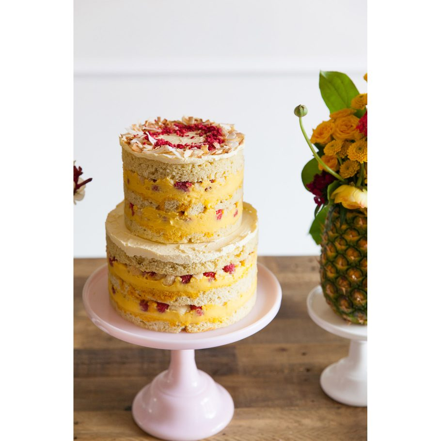 Coconut passion fruit cake with raspberries